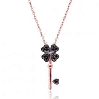 Necklace with key pendant and leaf black clover